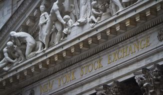 FILE - This Wednesday, July 8, 2015, file photo shows the exterior of the New York Stock Exchange. Global stocks are mixed, Monday, Jan. 22, 2018, after investors shrugged off the U.S. government shutdown. (AP Photo/Bebeto Matthews, File)