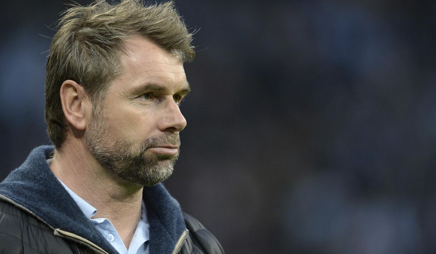 FILE - In this March 17, 2017 file photo Wuerzburg's coach Bernd Hollerbach attends the second league soccer match between TSV 1860 Munich and Wuerzburger Kickers in Munich, Germany. Struggling Hamburger SV has hired Hollerbach as coach to replace the sacked Markus Gisdol. The Bundesliga side says the 48-year-old Hollerbach has signed a deal through June 2019 and will be presented after taking charge of his first training session on Monday, Jan. 22, 2018. (Andreas Gebert/dpa via AP) via AP)