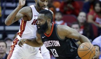 Houston Rockets guard James Harden (13) drives around Miami Heat forward Derrick Jones Jr. (5) during the first half of an NBA basketball game Monday, Jan. 22, 2018, in Houston. (AP Photo/Michael Wyke)