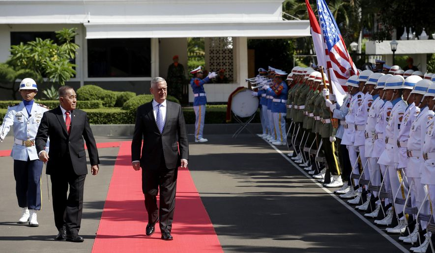 U.S. Defense Secretary Jim Mattis, center, with his Indonesian counterpart Ryamizard Ryacudu inspects a guard of honor during a welcoming ceremony prior their meeting in Jakarta, Indonesia, Tuesday, Jan. 23, 2018. (AP Photo/Tatan Syuflana)