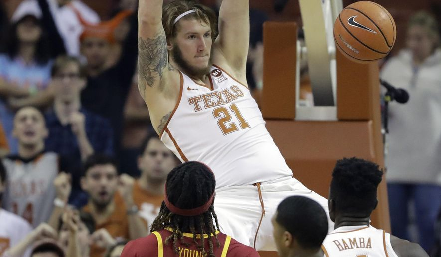 Texas forward Dylan Osetkowski (21) scores over Iowa State forward Solomon Young (33) and guard Donovan Jackson (4) during the first half of an NCAA college basketball game, Monday, Jan. 22, 2018, in Austin, Texas. (AP Photo/Eric Gay)