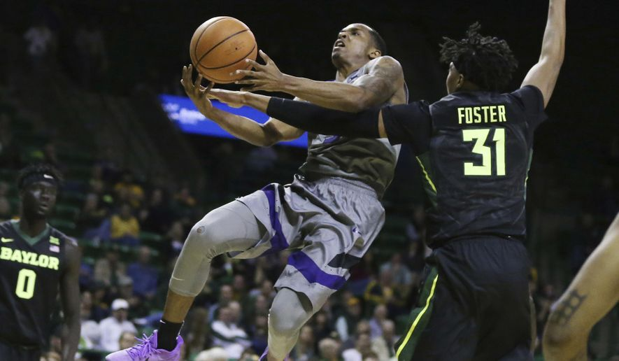 Kansas State guard Barry Brown, left, is fouled by Baylor forward Terry Maston, right, while driving to the basket in the second half of an NCAA college basketball game, Monday, Jan. 22, 2018, in Waco, Texas. (Rod Aydelotte/Waco Tribune Herald, via AP)