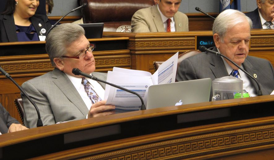 "House Republicans leader Lance Harris, R-Alexandria, left, and Rep. Charles ""Bubba"" Chaney, R-Rayville, read through Gov. John Bel Edwards' budget proposal on Monday, Jan. 22, 2017, in Baton Rouge, La. (AP Photo/Melinda Deslatte)"