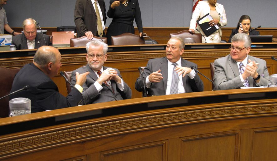 Reps. Johnny Berthelot, R-Gonzales; Reid Falconer, R-Mandeville; Jack McFarland, R-Winnfield; and Lance Harris, R-Alexandria, from left to right, talk about taxes Monday, Jan. 22, 2018, ahead of Gov. John Bel Edwards' presentation of his worst-case scenario budget if lawmakers don't replace $1 billion in expiring taxes. (AP Photo/Melinda Deslatte)