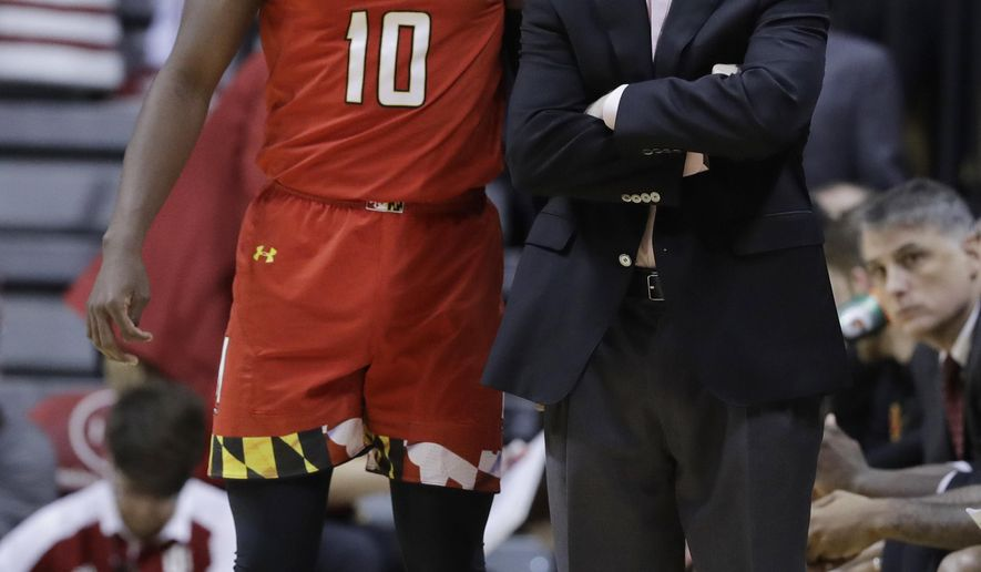 Maryland's Darryl Morsell (10) talks with head coach Mark Turgeon during the first half of an NCAA college basketball game against Indiana, Monday, Jan. 22, 2018, in Bloomington, Ind. (AP Photo/Darron Cummings)
