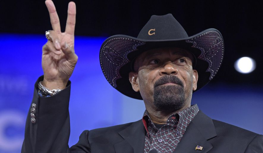 "FILE - In this Feb. 23, 2017, file photo, Milwaukee County Sheriff David Clarke speaks at the Conservative Political Action Conference (CPAC) in Oxon Hill, Md. Daniel Black, a man who sued Milwaukee's former sheriff after he was detained for shaking his head at the sheriff, testified in federal court Monday, Jan. 22, 2018, in Milwaukee, saying he felt he ""had a target"" on him because of the lawman's taunting Facebook posts. Black's lawsuit stems from an encounter he had last January with Clarke on a flight from Dallas to Milwaukee. (AP Photo/Susan Walsh, File)"