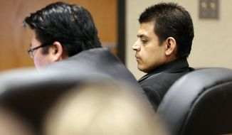 FILE - In this  March 23, 2017, file photo, Edwin Lara sits with his defense team during a hearing in Judge A. Michael Adler's courtroom at the Deschutes County Circuit Court in Bend, Ore. Lara who is accused of killing a woman during his shift as a campus safety officer at an Oregon community college has pleaded guilty to aggravated murder. Lara entered the plea Monday, Jan. 22, 2018. He was set to be sentenced at a hearing expected to end in the afternoon. (Joe Kline/The Bulletin via AP, File)