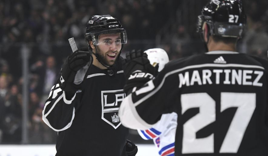 Los Angeles Kings center Michael Amadio, left, is congratulated by defenseman Alec Martinez after scoring against the New York Rangers during the second period of an NHL hockey game Sunday, Jan. 21, 2018, in Los Angeles. (AP Photo/Michael Owen Baker)