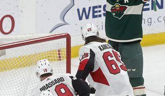 Minnesota Wild's Zach Parise, top, celebrates his goal against Ottawa Senators goaltender Mike Condon in the first period of an NHL hockey game Monday, Jan. 22, 2018, in St. Paul, Minn. (AP Photo/Jim Mone)
