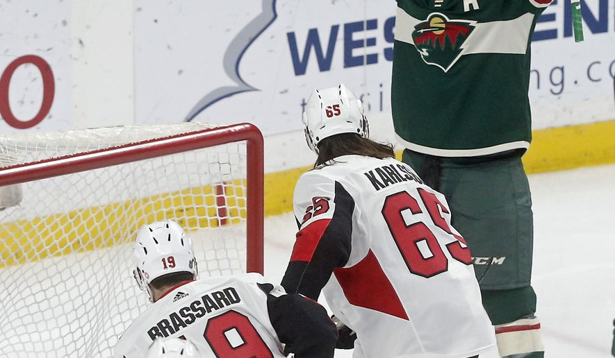 Minnesota Wild's Zach Parise, top, celebrates his goal against Ottawa Senators goaltender Mike Condon in the first period of an NHL hockey game Monday, Jan. 22, 2018, in St. Paul, Minn. (AP Photo/Jim Mone)