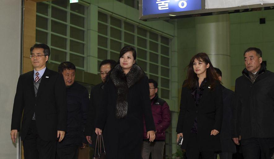 North Korean Hyon Song Wol, center, the leader of Pyongyang's all-female Moranbong Band, leaves for North Korea at the Inter-Korean Transit Office in Paju, South Korea, Monday, Jan. 22, 2018. (Korea Pool via AP)