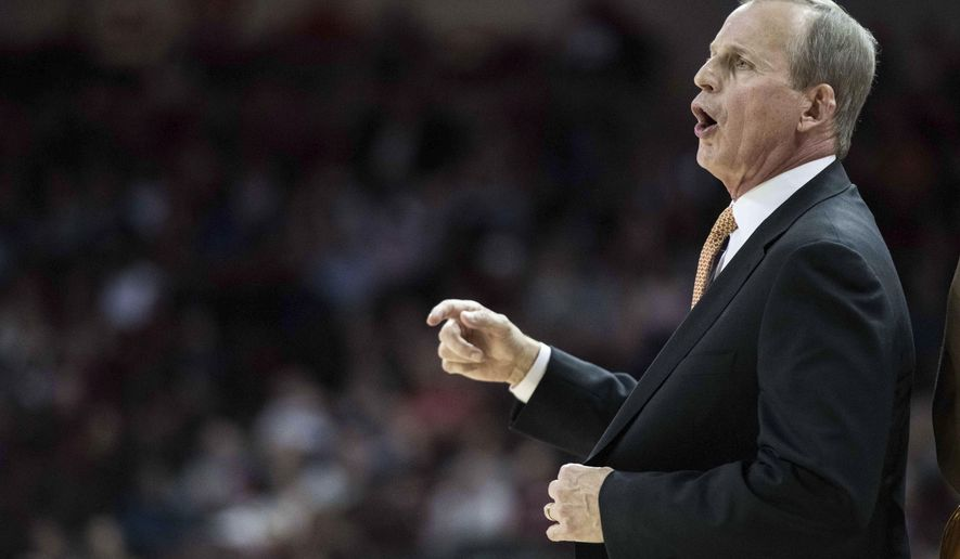 Tennessee head coach Rick Barnes communicates with players during the first half of an NCAA college basketball game against South Carolina, Saturday, Jan. 20, 2018, in Columbia, S.C. (AP Photo/Sean Rayford)