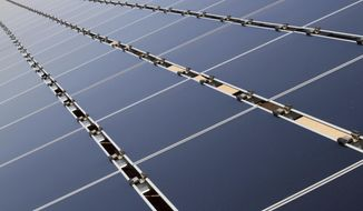 This April 20, 2011, file photo shows some of the 30,000 solar panels that make up the Public Service Company of New Mexico's new 2-megawatt photovoltaic array in Albuquerque, N.M. (AP Photo/Susan Montoya Bryan,File) **FILE**