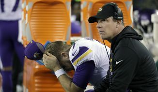 Minnesota Vikings quarterback Case Keenum, left, reacts on the bench beside offensive coordinator Pat Shurmur during the second half of the NFL football NFC championship game against the Philadelphia Eagles, in Philadelphia. (AP Photo/Matt Slocum)