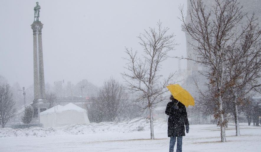 """Sarah Wilson walks down the hill along Kellogg Avenue in St. Paul,. Minn., with an umbrella to shield the wind and snow Monday, Jab. 22, 2018. """"I walk every day no matter the weather,"""" said Wilson. The Minnesota Department of Transportation is advising against traveling in portions of southwest Minnesota because of white out conditions. The visibility issue extends from Worthington east to Albert Lea and north to Mankato. The roadways involved include portions of Highway 30, Highway 91 and Highway 59. A blizzard warning is in effect for much of south central and southeastern Minnesota.  (Leila Navidi /Star Tribune via AP)"""