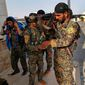 The Defense Department's support strategy was on prominent display in the fight against Islamic State, with Iraqi forces and Syrian Kurdish fighters taking the lead on the ground in ousting the terrorist group from its strongholds in Mosul and Raqqa. (Associated Press/File)