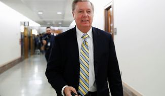 """I'm trying to create a process where all this bipartisanship has a place to go,"" said Sen. Lindsey Graham, South Carolina Republican. Now Sen. John Cornyn and Sen. Richard Durbin are leading the talks. (Associated Press)"