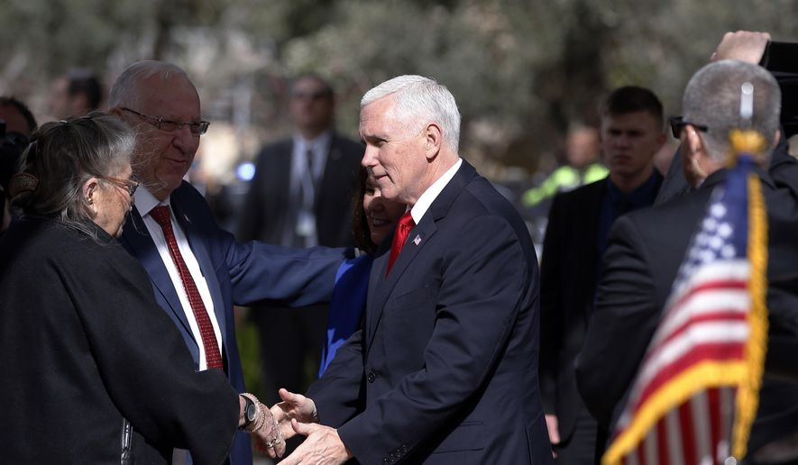 U.S. Vice President Mike Pence, right, shakes hands with the wife of Israel President Reuven Rivlin, Nechama, during a formal reception ceremony at the President's residence in Jerusalem, Tuesday Jan. 23, 2018. (Ronen Zvulun/Pool via AP)