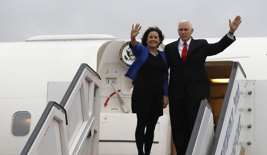 U.S. Vice President Mike Pence and his wife Karen wave as they board an airplane ahead of their departure from Ben Gurion International Airport, in Lod, near Tel Aviv, Israel, Tuesday, Jan. 23, 2018. (Ronen Zvulun/Pool photo via AP)
