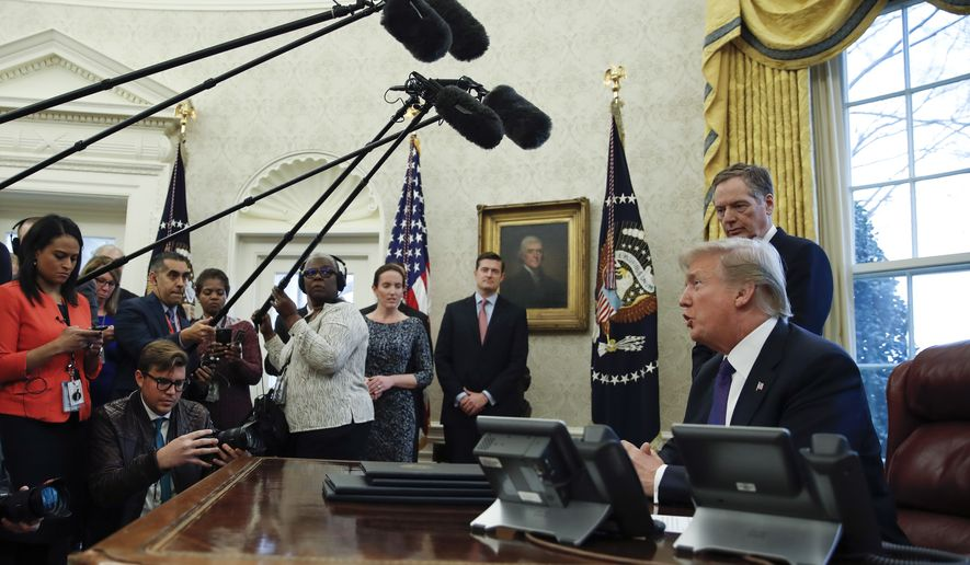 "President Donald Trump, joined by U.S. Trade Representative Robert Lighthizer, speaks to media after signing Section 201 actions in the Oval Office of the White House in Washington, Tuesday, Jan. 23, 2018. Trump says he is imposing new tariffs to ""protect American jobs and American workers."" Trump acted to impose new tariffs on imported solar-energy components and large washing machines in a bid to help U.S. manufacturers. (AP Photo/Carolyn Kaster)"