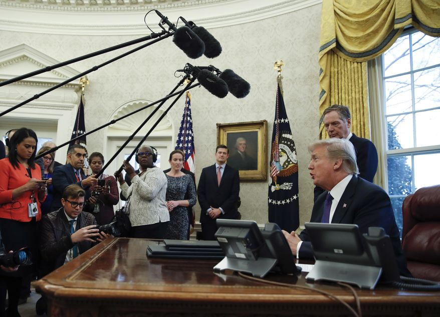 """President Donald Trump, joined by U.S. Trade Representative Robert Lighthizer, speaks to media after signing Section 201 actions in the Oval Office of the White House in Washington, Tuesday, Jan. 23, 2018. Trump says he is imposing new tariffs to """"protect American jobs and American workers."""" Trump acted to impose new tariffs on imported solar-energy components and large washing machines in a bid to help U.S. manufacturers. (AP Photo/Carolyn Kaster)"""