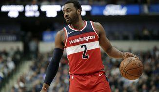Washington Wizards' John Wall (2) handles the ball during an NBA basketball game against the Dallas Mavericks on Monday, Jan. 22, 2018, in Dallas. (AP Photo/Tony Gutierrez)