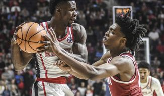Mississippi's Terence Davis II is defended by Alabama's Herbert Jones (10) during an NCAA college basketball game in Oxford, Miss. on Tuesday, Jan. 23, 2018. (Bruce Newman/The Oxford Eagle via AP)
