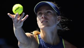 Germany's Angelique Kerber serves to United States' Madison Keys during their quarterfinal at the Australian Open tennis championships in Melbourne, Australia, Wednesday, Jan. 24, 2018. (AP Photo/Andy Brownbill)