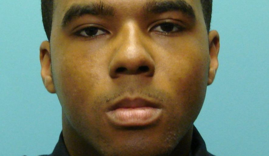 FILE - This undated file photo provided by the Baltimore Police Department shows Detective Marcus Taylor. A jury has been selected in the trial of Taylor and a fellow police officer charged in one of the largest scandals in the Baltimore Police Department's history. Taylor has pleaded not guilty to charges of racketeering and robbery that he allegedly committed while he was a member of a disbanded police unit called the Gun Trace Task Force. (Baltimore Police Department via AP, File)