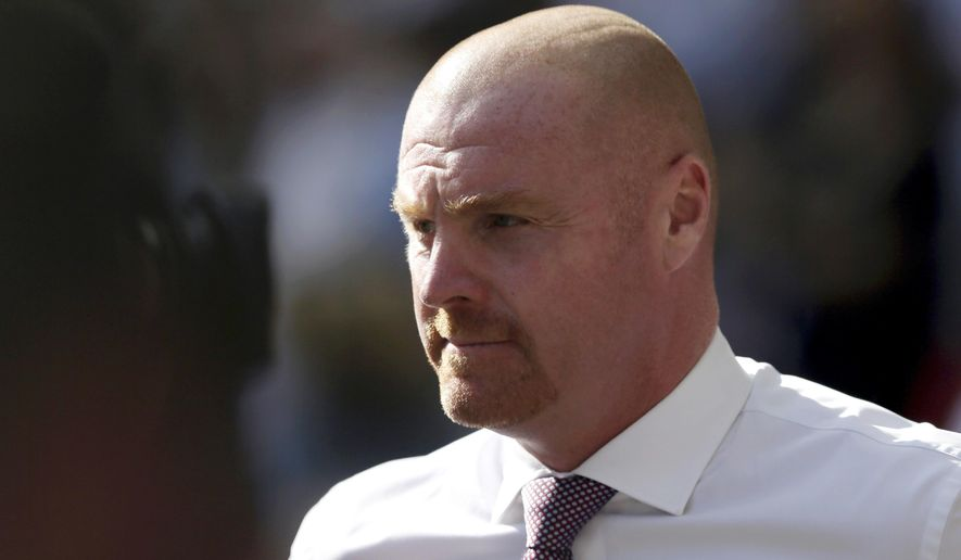 FILE - In this Sunday, Aug. 27, 2017 file photo, Burnley's manager Sean Dyche looks on during the English Premier League soccer match between Tottenham Hotspur and Burnley at Wembley stadium in London. Burnley tied manager Sean Dyche to a new 4 1/2-year deal and signed former England winger Aaron Lennon on loan from Everton on Tuesday, Jan. 23, 2018. (AP Photo/Tim Ireland, File)
