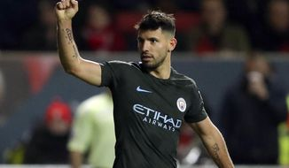 Manchester City's Sergio Aguero celebrates scoring his side's second goal of the game during the English League Cup semi final, second leg match against Bristol City at Ashton Gate, Bristol, England, Tuesday, Jan. 23, 2018. (Nick Potts/PA via AP)