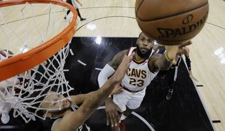 Cleveland Cavaliers forward LeBron James (23) shoots past San Antonio Spurs forward Kyle Anderson (1) during the first half of an NBA basketball game, Tuesday, Jan. 23, 2018, in San Antonio. James passed the 30,000 career points mark in the first quarter. (AP Photo/Eric Gay)