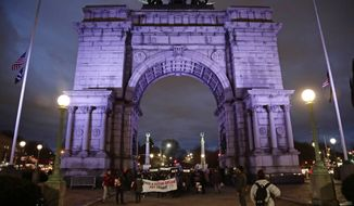 CORRECTS TO SCHUMER-Protestors gather at Grand Army Plaza near the home of Sen. Charles Schumer, D-N.Y Tuesday, Jan. 23, 2018, in New York. (AP Photo/Frank Franklin II)