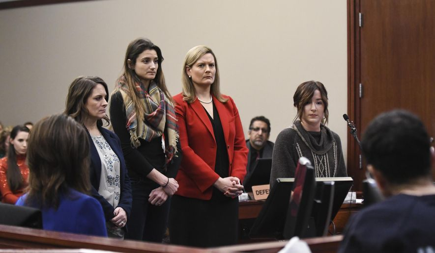 Former gymnast Bailey Lorencen, right, confronts Larry Nassar, Monday, Jan. 22, 2018, during the fifth day of victim impact statements in Ingham County Circuit Court in Lansing, Mich. Also pictured are, from. left;  Det. Lt. Andrea Munford of the MSU Police Dept., Maddie Bonafiglio, and Asst. Prosecutor Angela Povilaitis.  Nassar will be sentenced on sexual assault charges this week. He has admitted molesting athletes during treatment when he was employed by Michigan State University and USA Gymnastics, which trains Olympians.   (Matthew Dae Smith/Lansing State Journal via AP)