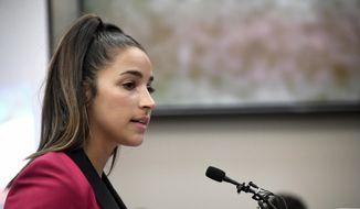 FILE- In this Jan. 19, 2018, file photo, Olympic gold medalist Aly Raisman gives her victim impact statement in Lansing, Mich., during the fourth day of sentencing for former sports doctor Larry Nassar, who pled guilty to multiple counts of sexual assault. (Dale G. Young/Detroit News via AP, File) **FILE**