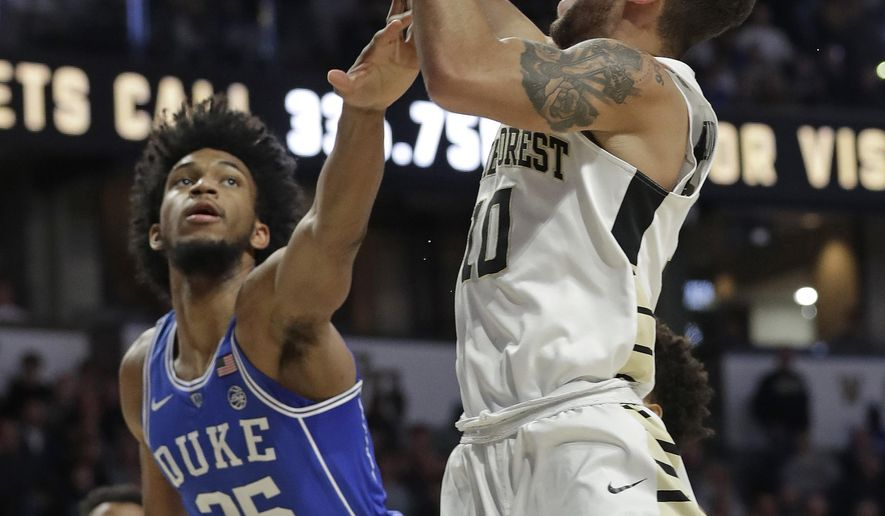Wake Forest's Mitchell Wilbekin (10) shoots over Duke's Marvin Bagley III (35) during the first half of an NCAA college basketball game in Winston-Salem, N.C., Tuesday, Jan. 23, 2018. (AP Photo/Chuck Burton)