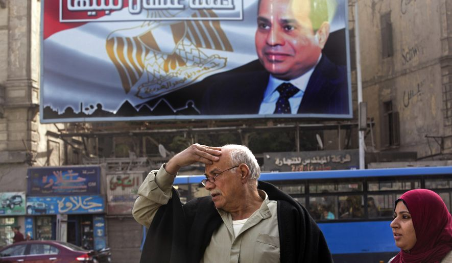 "A billboard supporting Egyptian President Abdel-Fattah el-Sissi in the presidential election scheduled for March hangs in downtown Cairo, Egypt, Monday, Jan. 22, 2018.  El-Sissi is virtually guaranteed to win a second four-year term amid a heavy clampdown on dissent. Arabic reads, ""So you can build it."" (AP Photo/Amr Nabil)"