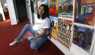 In a Jan. 18, 2018 photo, Cinthia Osorio of Dover poses for a photo at the offices of Wind of the Spirit Immigrant Resource Center in Morristown, N.J., where she works as a community organizer. The 22-year-old is a DACA recipient who has been outspoken about needed legislation to give a path to citizenship for other DACA recipients. January 18, 2018. Morristown, NJ.  (Bob Karp/The Daily Record via AP)