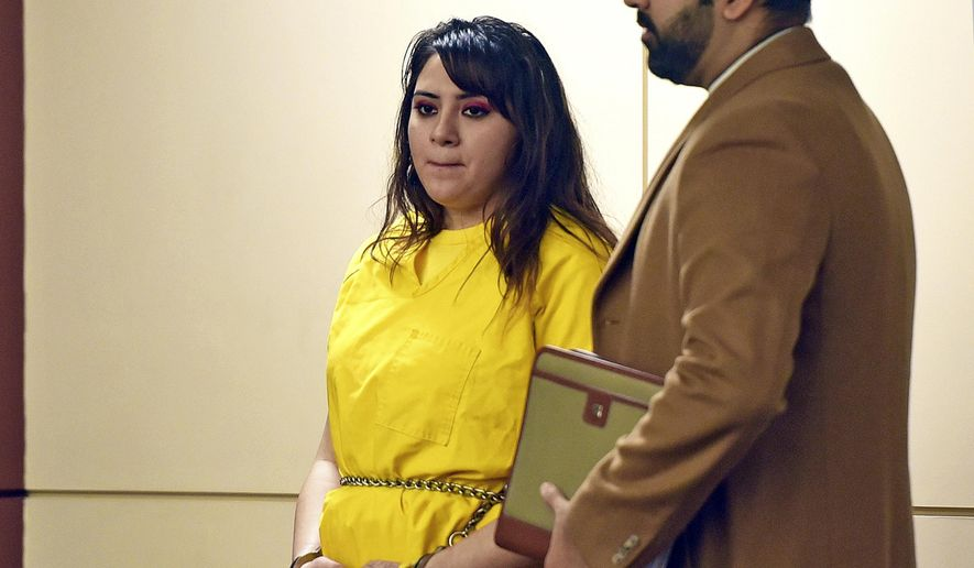 Obdulia Sanchez stands with her attorney, Merced County Public Defender Ramnik Samrao, in Merced Superior Court Tuesday, Jan. 23, 2017. Sanchez pleaded no contest to charges she was driving drunk while livestreaming the July 21, 2017 crash that killed her younger sister. The charges include gross vehicular manslaughter, drunken driving, child endangerment charges and several enhancements. (Vikaas Shanker /The Merced Sun-Star via AP)