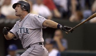 FILE - In this May 27, 2003, file photo, Seattle Mariners' Edgar Martinez hits a three-run home run against the Kansas City Royals in the third inning of a baseball game in Kansas City, Mo. Chipper Jones, Jim Thome and Vladimir Guerrero appear likely to be elected to the Baseball Hall of Fame on Wednesday, Jan. 24, 2018, and Martinez and Trevor Hoffman figure to be close to the necessary 75 percent. (AP Photo/Ed Zurga, File)