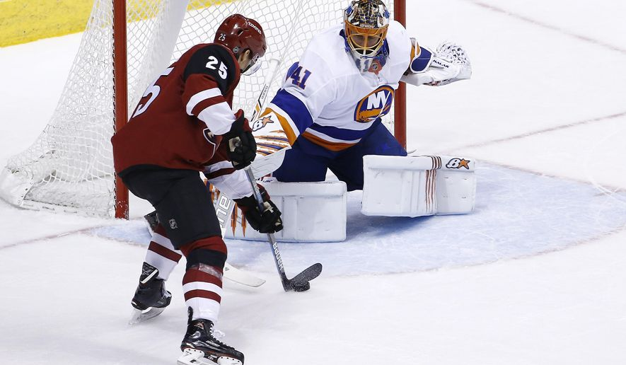 Arizona Coyotes center Nick Cousins (25) moves in for the winning score against New York Islanders goaltender Jaroslav Halak (41) during overtime of an NHL hockey game, Monday, Jan. 22, 2018, in Glendale, Ariz. The Coyotes defeated the Islanders 3-2. (AP Photo/Ross D. Franklin)