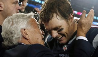New England Patriots owner Robert Kraft, left, embraces quarterback Tom Brady after defeating the Jacksonville Jaguars in the AFC championship NFL football game, Sunday, Jan. 21, 2018, in Foxborough, Mass. The Patriots won 24-20. (AP Photo/Winslow Townson)