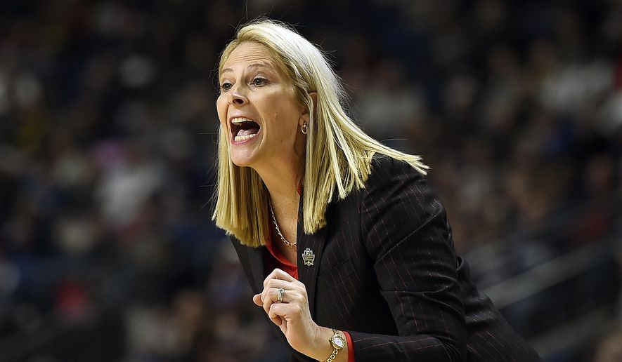 FILE - In this March 25, 2017, file photo, Maryland head coach Brenda Frese shouts instructions during the second half of a regional semifinal game against Oregon in the NCAA women's college basketball tournament, in Bridgeport, Conn. Seems as if the three-time Big Ten women's basketball champions aren't ready to hand over the crown. With a team that has very little depth or experience, Maryland again stands along atop the conference.(AP Photo/Jessica Hill, File) **FILE**