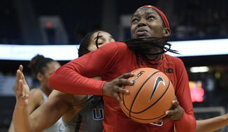 In this Nov. 19, 2017, file photo, Maryland's Kaila Charles, right, turns to shoot as Connecticut's Gabby Williams, back, defends during the first half an NCAA college basketball game, in Hartford, Conn. (AP Photo/Jessica Hill, File) ** FILE **