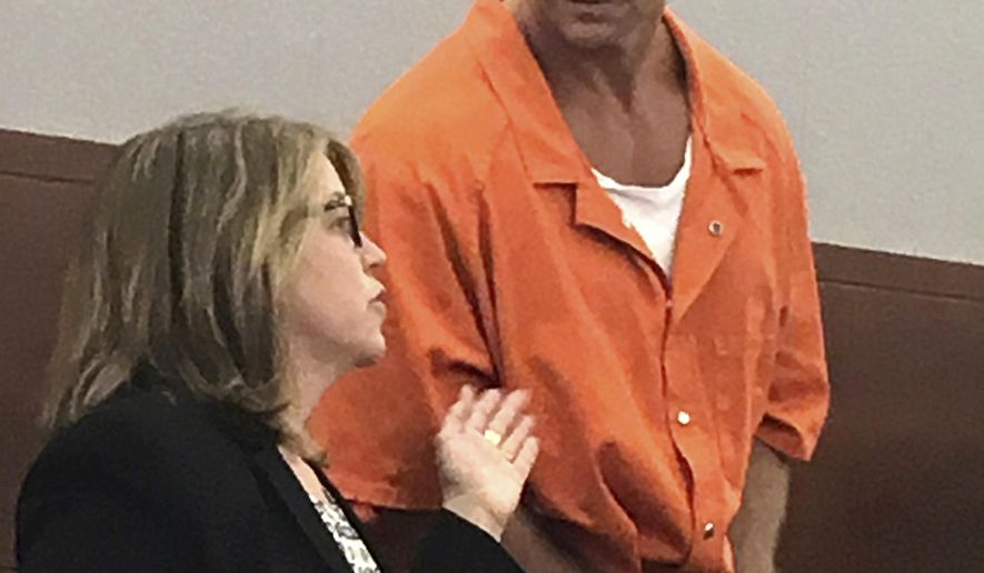 FILE - In this Aug. 17, 2017 file photo, Nevada death row inmate Scott Raymond Dozier confers with Lori Teicher, a federal public defender involved in his case, during an appearance in Clark County District Court in Las Vegas. Attorneys for Dozier, whose execution is on hold, told the state Supreme Court in filings Tuesday, Jan. 23, 2018 that his execution using a never-before-tried lethal injection protocol would be less humane than a veterinary euthanasia. (AP Photo/Ken Ritter, File)