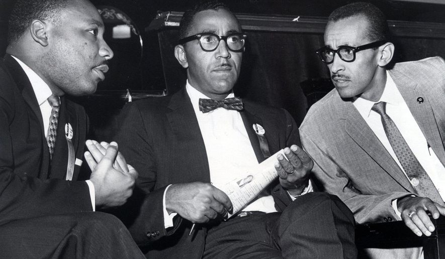 "In a Sept. 25, 1963 photo, The Rev. Martin Luther King,Jr., left, VP Joseph E. Lowery, and Wyatt Tee Walker, right, executive director of the SCLC meet at First African Baptist Church, for the SCLC convention in Richmond, Va. The Rev. Wyatt Tee Walker, who helped assemble the Rev. Martin Luther King Jr.'s famous ""Letter From Birmingham Jail"" from notes the incarcerated King wrote on paper scraps and newspaper margins, died Tuesday morning, Jan. 23, 2018, in Chester, Va., said his daughter Patrice Walker Powell. He was either 88 or 89. Family records showed different years of birth, said Powell, who confirmed his death.  (Carl Lynn/Richmond Times-Dispatch via AP)"
