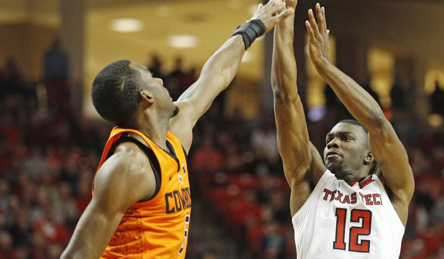 Texas Tech's Keenan Evans (12) shoots over Oklahoma State's Tavarius Shine (5) during the first half of an NCAA college basketball game Tuesday, Jan. 23, 2018, in Lubbock, Texas. (AP Photo/Brad Tollefson)