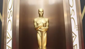 FILE - In this March 2, 2014 file photo, an Oscar statue is displayed at the Oscars at the Dolby Theatre in Los Angeles. Nominations for the 90th Oscars will be announced on Tuesday, Jan. 23, 2018. (Photo by Matt Sayles/Invision/AP, File)