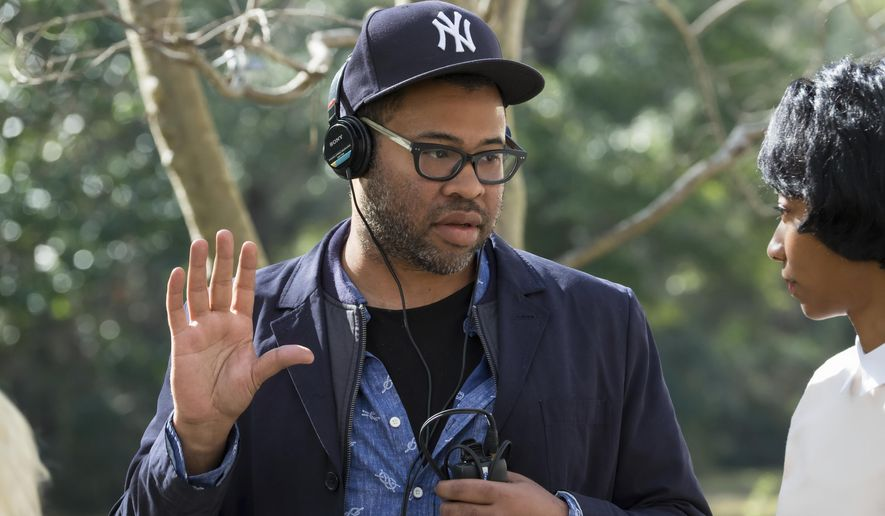 "This image released by Universal Pictures shows director Jordan Peele on the set of ""Get Out.""  Peele was nominated for an Oscar for best director, Tuesday, Jan. 23, 2018. The 90th Oscars will air live on ABC on Sunday, March 4.  (Justin Lubin/Universal Pictures via AP)"