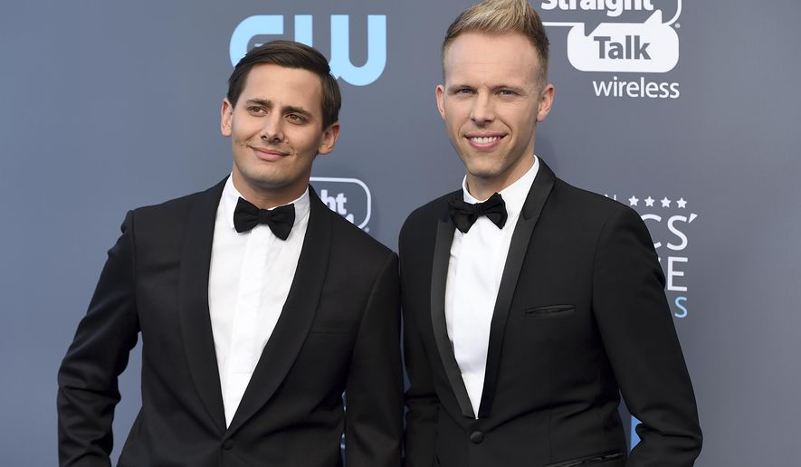 "FILE - In this Jan. 11, 2018 file photo, Benj Pasek, left, and Justin Paul arrive at the 23rd annual Critics' Choice Awards in Santa Monica, Calif. The pair were nominated for an Oscar for best original song for ""This Is Me,"" from the film ""The Greatest Showman."" (Photo by Jordan Strauss/Invision/AP, File)"